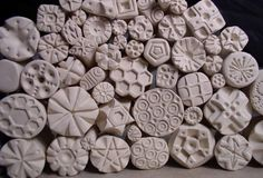 Ideas for home-made stamps.  One method, aside from hand-carving using other objects, is to press other objects, such as buttons, into the end of the clay handle.  Handles are simply cylinders, which can be extruded if you have an extruder.