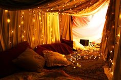 Use nice blankets, or sheer curtains with stringed lights. Thrown some nice pillows, with comfortable blankets to lounge on.