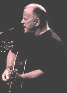christy moore, irish traditional musician, a song writer and a poet.