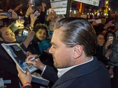 """Leonardo DiCaprio - Rome, Italy - January 15, 2016: Actor Leonardo DiCaprio arrives in Rome leg of a European tour to promote his latest film, """"The Revenant"""". Italian fans welcome him with enthusiasm and DiCaprio is generous in signing autographs."""