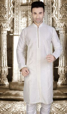 Perfect for all wedding occasions, this off white shade Banarasi silk kurta suit. This engaging attire is displaying some astounding embroidery done with lace and resham work. #Men'sKurtaPajama