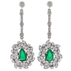 Retro Dramatic Emerald Diamond Gold Earrings | From a unique collection of vintage drop earrings at https://www.1stdibs.com/jewelry/earrings/drop-earrings/