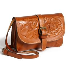 Tooled Leather mini crossbody bag. Embossed floral design leather.  Magnetic closure with an external zipped pocket and many interior compartments to fit all your on the go essentials.  Adjustable/removable strap. Patricia Nash Bags Crossbody Bags