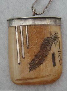 Sterling silver and scrimshawed ivory pendant