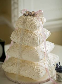pillow cake with ribbons; There are so many trends, including the use of edible paints, frills, flexible sugar lace and chevron patterns. However, old school piping skills are making a comeback and uber tall wedding cakes seem to be making a comeback.
