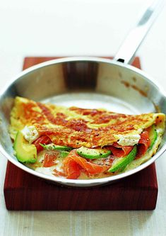 Smoked salmon omelette - Make the perfect omelette. Speedy and full of protein, this breakfast is made extra special with smoked salmon, avocado and a pinch of cayenne to add a little heat.