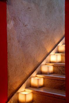 Candles illuminate the stairwell at El Fenn, Marrakech