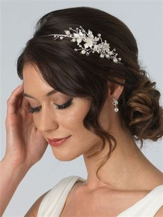 Pretty Floral Side Headband. Delicate ivory leaves and pearl accents. Perfect bridal headband.