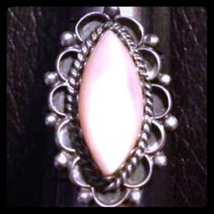 """Signed Artisan Sterling Mother of Pearl Ring  Beautiful Navajo Native American vintage artisan handcrafted sterling silver ring featuring a marquise pink Mother of Pearl shell surrounding by twisted rope and petals. Size is 7.75. Signed """"S"""" by the Navajo artist Sarah Chee. Vintage Jewelry Rings"""