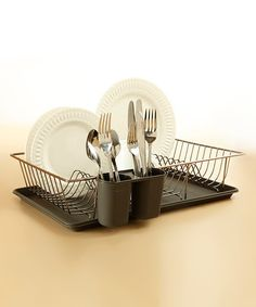 Keep countertops clean and tidy with this organizing essential. Perfect for resting next to the sink, this drying rack offers a spot for resting dishes and utensils and even comes with a tray for catching water.Includes rack, tray and cutlery holderDishes and cutlery not included19'' W x 4'' H x 12'' DRack: steelTray: plasticImported
