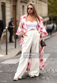 A guest is seen wearing a floral coat, white top and cream pants outside the Altuzarra show during Paris Fashion Week on September 2019 in Paris, France. Get premium, high resolution news photos at Getty Images Cream Pants, White Tops, Paris Fashion, Street Style, News, Coat, Floral, How To Wear, Dresses