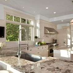 Bright Beautiful Kitchen with Alaskan White Granite Countertops. Not sure about strange blobs in foreground though
