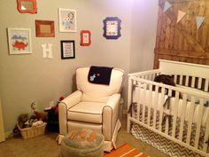 The Zig Zag Crib Bedding looks awesome in this rustic nursery!