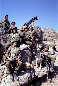 Soviet Army engineers pose with bomb-sniffing dogs in Afghanistan, c. 1980s.