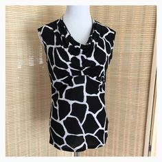 MICHAEL Michael Kors Black & White Top Sz. M. Beautiful fitted giraffe print, this top is perfect day or night. Top has slight cowl neck, tuck at bust line. Fits perfectly on my Sz. 6-8 dress form. Rayon. Small bluish stains on back left side, not very noticeable. Shown in last photo. MICHAEL Michael Kors Tops Blouses