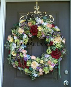 This is a wreath that I created with leftover flowers and sprays on a honeysuckle base.