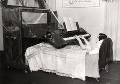 Piano bed, precursor to portable pianos or keyboards, allows a bedridden person to still play piano.