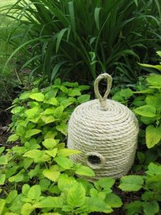 Bee skeps add a rustic look and are easy to make. You'll love this tucked among your summer flowers.