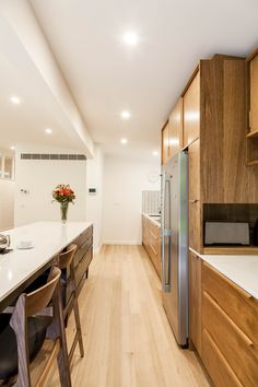 Contemporary kitchen that was designed to replace a 1980's kitchen in a mid-century modern renovation by Secret Design Studio, Blackburn, Melbourne, Victoria. In association with Sawdust Timber Furniture and Detail 9.