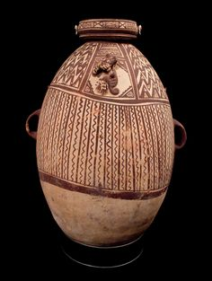 Pottery Vessel 399. Description: Exquisite Large Chancay Pottery Vessel -A.D. 11-2-1532 Olla or water jar. Decorated with a feline figure from the Chancay Valley, Peru Gift of Dr. Edward Howell to the