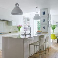 See all our stylish kitchen design ideas. In keeping with the bright colour palette of this London family home is the seating in the kitchen.