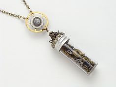 Bottle Necklaces with Steampunk large gears  http://steampunknation.com/  #bottlenecklace #steampunknecklace #timeinabottle