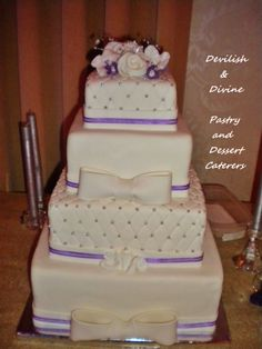 Stunning purple accented, 4-tier, quilted, with silver dragees and handmade flowers & bows