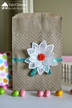 This art that makes me happy: Vellum Flower Tutorial and Spring card and gift bag for The Little Blue House. Vicki Used AccuCut Flower #6, one of our favorites see more here http://www.accucutcraft.com/catalogsearch/result/?q=F1445&order=relevance&dir=desc