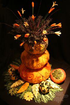 carved stacked pumpkin display