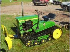 John deere garden tractor on tracks with plow. John Deere Garden Tractors, Yard Tractors, Small Tractors, John Deere Equipment, Old Farm Equipment, Heavy Equipment, Garden Equipment, Antique Tractors, Vintage Tractors