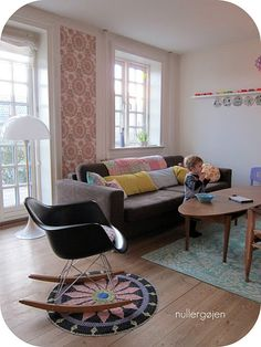 Beautiful living room. From someplace Scandinavian no doubt. They get all the good stuff.