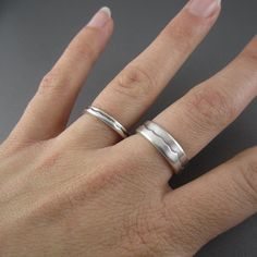 This nature inspired handcrafted sterling silverwedding ring is durable and comfortable, perfect for the outdoor enthusiast and active, modern lifestyle. Our waves rings are handmade by the shores of Lake Superior, the perfect ring for your greatest love of all. Product features: Eco-friendly recycled sterling silver. Available in 3mm or 6mm (as pictured) widths. Handcrafted in Marquette, Michigan. Customize this ring: Upgrade to recycled gold - yellow, rose or palladium white. You can…