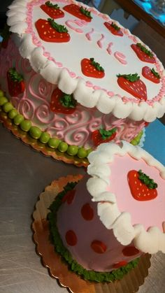 A strawberry shortcake themed cake and little smash cake for a one year old. By christinascakery.com