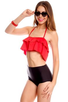 This two piece swimsuit features a padded chest, top ruffle design, hi waist bottoms, Great for any occasion, Bust measures about 12 inches, Waist measures about 11 inches.   Polyester Spandex  Model Info: Height: 5ft 11in | Waist: 24in | Hips: 25in | Chest: 34C  Wear Size: Medium