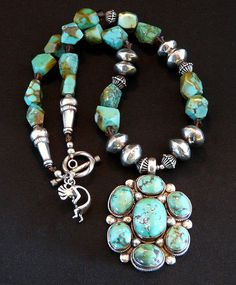 Our eye-catching Necklace showcases a 7-Stone Tibetan Turquoise & Sterling Pendant displaying rich shades of green with brown Matrix. The Turquoise Stones are set in raised Sterling Bezels, wrapped in