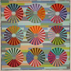 Brown Bag Quilt challenge: quilt by Fiberchick.  Giant wheels were appliqued to a strip-pieced background.