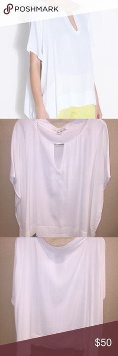 Diane Von Furstenberg Beonica Top White half dolman sleeve top with bateau neck, hardware insert at keyhole. Draped handkerchief at back. Classy and sophisticated! Great condition, only worn twice. Diane von Furstenberg Tops Blouses
