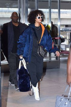 Rihanna, the popular singer, was recently spotted at the airport wearing the perfect outdoor winter look. She carried the winter baggy jacket look effortlessly teaming it up with white boots and Andy Wolf's 'Jan' sunglasses.