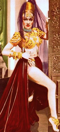 MARLENE DIETRICH as Jamilla in KISMET (aka Oriental Dream) 1944. This is the famous film Marlene painted her legs gold for a harem dancing scene, and Marlene's first in colour since her very early colour 1936 film The Garden of Allah. Which was really a grand scale colour test for Zanuck's 1939 classic Gone With The Wind. Cover (DETAIL) vintage Japanese program. (please follow minkshmink on pinterest)