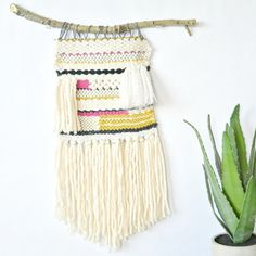 Check out how to weave a simple wall hanging with a lap loom. Tutorial and pictures available.