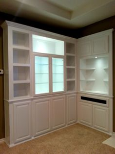 white corner cabinet with built in lighting