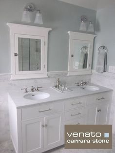 white vanity with carrara marble marble tile