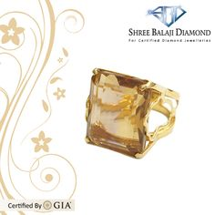 17K Gold Ring with 14.2 carat Yellow Topaz