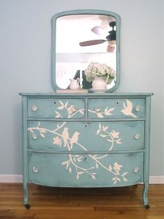 Annie Sloan Chalk Paint (custom mix), then hand-painted with a bird and branch design on the drawer faces. This dresser was the distressed and clear waxed for durable, protective finish.