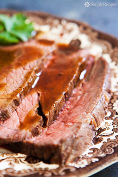 Classic roast beef recipe using rump roast, round roast, or sirloin tip.  This slow roasting method at low heat is good for tougher cuts of beef; the lower heat prevents any gristle from getting too tough. ~ SimplyRecipes.com