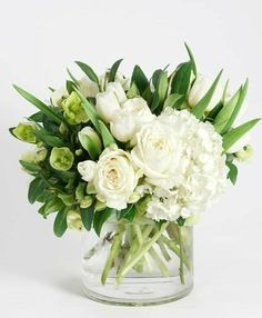 This refreshingly simple design features an elegant collection of crisp white blooms including hydrangea, tulips, roses and our unique heleborus arranged in our signature glass cylinder vase. Tulpen Arrangements, White Flower Arrangements, Floral Centerpieces, Deco Floral, Arte Floral, Funeral Flowers, Wedding Flowers, Send Flowers, Flowers Vase