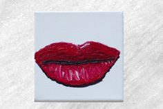Ive always wanted to attempt painting full and intense red lips. On this 5 by 5 canvas, I was able to create my piece using a mixture of acrylics