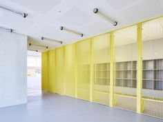 Image 12 of 32 from gallery of Nathalie Mauclair Gymnasium / Schemaa. Photograph by David Foessel Interior Cladding, Interior Architecture, Cafe Interior, Interior Design, Yellow Office, Space Dividers, Barn Renovation, Wall Finishes, Co Working