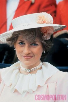 Lady Diana Spencer, wearing a peach outfit and Freddy Fox boater hat with specially made pompoms by John Boyd, attends Royal Ascot June 3, 1981 in London.