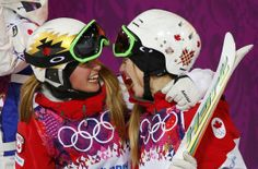 Second-placed Chloe Dufour-Lapointe of Canada congratulates her sister, winner Justine Dufour-Lapointe, after the women's freestyle skiing m...